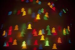 Färgrika ljusa träd för bokehtapetxmas Royaltyfri Fotografi