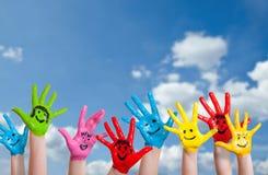Färgrika målade händer med smileys Fotografering för Bildbyråer