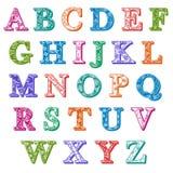Färgrika mönstrade alfabetbokstäver för färdig uppsättning Arkivfoton
