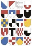 Färgrika mallar för vapensköldar Uppsättning av tjugo sköldar Arkivbild