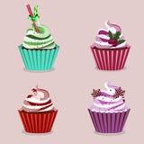 Färgrika muffin för jul Fotografering för Bildbyråer