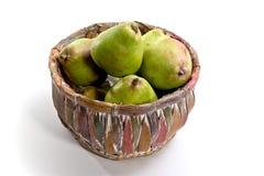 färgrika nya pears för korg Royaltyfria Foton
