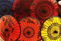Färgrika pappers- paraplyer Fotografering för Bildbyråer