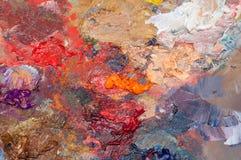 Färgrika penseldrag på konstnärs palett Royaltyfri Fotografi