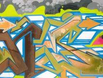 Färgrika pilar och linjer på en cementvägg Arkivbilder
