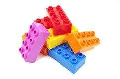 Färgrika plast- kvarter för leksak Arkivfoto
