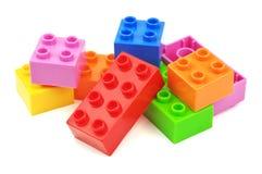 Färgrika plast- kvarter för leksak Arkivfoton
