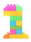 Färgrika plast- kvarter som bildar numret ett Arkivbilder