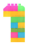 Färgrika plast- kvarter som bildar numret ett Arkivfoton