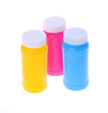 Färgrika plastic flaskor Royaltyfri Bild