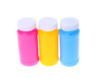 Färgrika plastic flaskor Royaltyfria Bilder