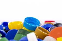 Färgrika plastic kapsyler Arkivfoton