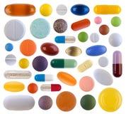 Färgrika preventivpillerar Arkivbilder
