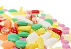 Färgrika preventivpillerar arkivfoto