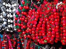 Färgrika regionala halsband på halsen Fotografering för Bildbyråer