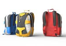 Färgrika ryggsäckar på vit bakgrund Royaltyfria Bilder