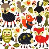 Seamless mönstra med skogsmarkdjur och fåglar Fotografering för Bildbyråer