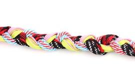 Färgrika shoelaces i pigtail Royaltyfri Bild