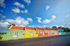 Färgrika slutta hus, Willemstad, Curacao Arkivfoto
