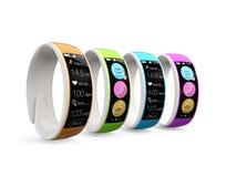 Färgrika smarta armband på vit bakgrund Fotografering för Bildbyråer