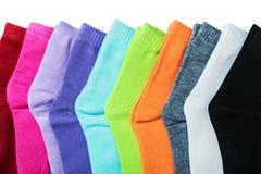 Färgrika sockor för textil som isoleras på en vit arkivfoto