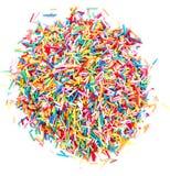Färgrika stänk för sockergodis som isoleras på vit bakgrund Arkivbilder