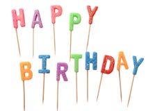 Färgrika stearinljus i bokstäver som säger den lyckliga födelsedagen som isoleras på vit bakgrund (den snabba banan) Royaltyfria Foton