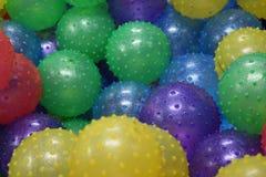 Färgrika Toy Rubber Balls With Rubber knoppar Fotografering för Bildbyråer