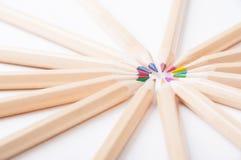Färgrika träblyertspennor på vit bakgrund Fotografering för Bildbyråer