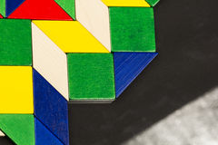 Färgrika trästycken för tangramteknik Royaltyfria Bilder