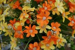 Färgrikt av den konstgjorda blomman för torkduk, slut upp Arkivfoton