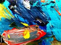 Färgrikt av plaskande färgabstrakt begreppbakgrund arkivfoto