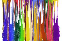 Färgrikt av plastisolfärgpulver dryper förbi i motsatta riktningar royaltyfria foton