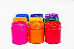 färgrikt av Plastisolfärgpulver i glasflaskor royaltyfria foton