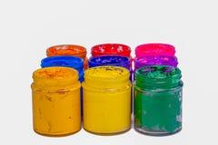 färgrikt av Plastisolfärgpulver i glasflaskor arkivfoto