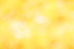 Färgrikt av suddig guling för bokehljus Arkivfoton