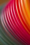 Färgrikt för konstvirvel för röd färg runt abstrakt begrepp Arkivfoto