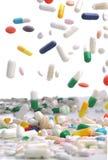 Färgrikt falla för medicinpreventivpillerar Royaltyfria Bilder