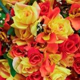 Färgrikt handgjort fejkar rosor Arkivfoto