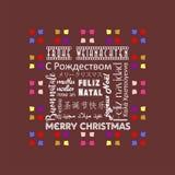 Färgrikt julhälsningkort som är skriftligt i tysk för flera språk, brun färg Royaltyfri Bild