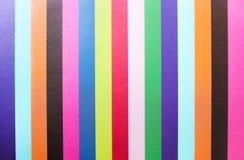 Färgrikt mångfärgat papper för bästa sikt i linjen modellbakgrund arkivfoto