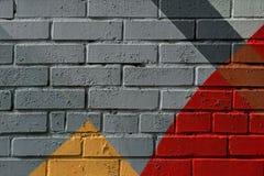 Färgrikt mycket litet fragment av gatagrafitti, tegelstenvägg Abstrakta idérika teckningsmodefärger För bakgrunder Royaltyfri Fotografi