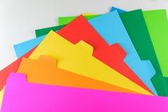 Färgrikt papper som isoleras på vit bakgrund Royaltyfri Foto
