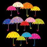Färgrikt paraply på svart bakgrund Royaltyfri Fotografi