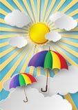 Färgrikt paraply som högt flyger i luften Royaltyfria Foton