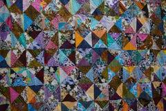 färgrikt patchworktäcke Royaltyfri Bild