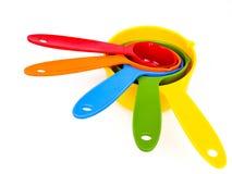 Färgrikt plast- mäta redskap arkivfoto