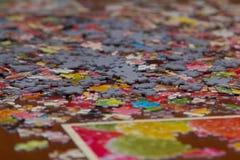 Färgrikt pussel på skrivbordet Fotografering för Bildbyråer