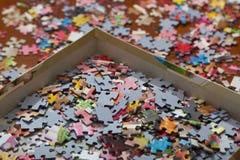 Färgrikt pussel på skrivbordet Royaltyfria Bilder