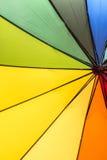 Färgrikt regnbågeparaply Royaltyfria Foton